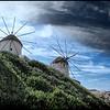 Mykonos Windmills Peaking Over The Hill