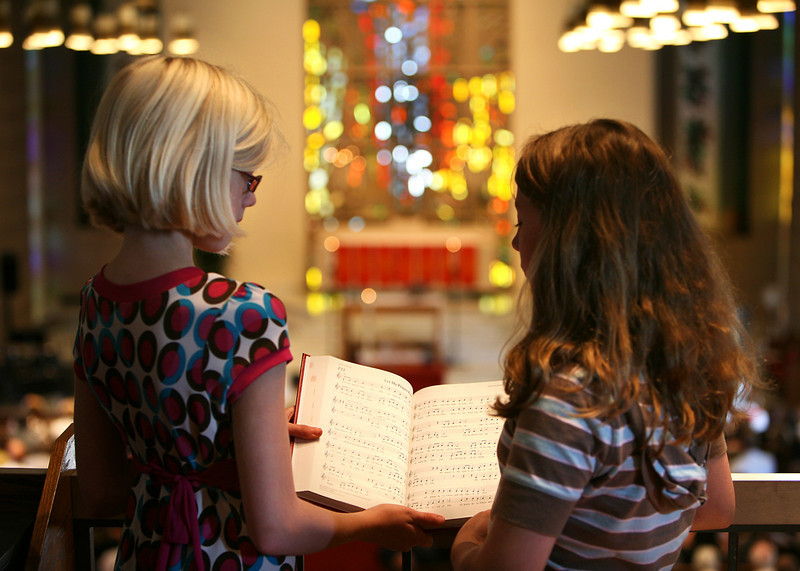 Helen and Sara share a hymnal