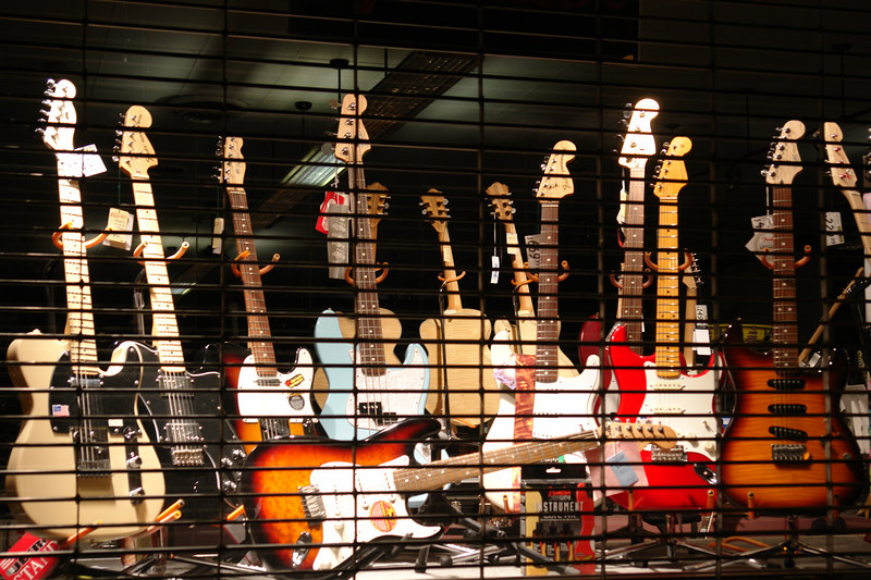 April.17,2006  <U>Prisoners of Rock'n'Roll...</U>  A musical instruments store showcases its guitars at night
