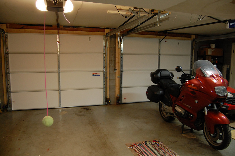 11-23-09:  Dad and I hung a couple of new garage doors this past week