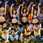 Los Angeles Laker Girls perform behind photographers on the sidelines during Game 2 of the NBA Finals between the Los Angeles Lakers and the Orlando Magic in Los Angeles June 7, 2009.     REUTERS/Mike Blake (I bought this image from Reuters and have permission to display it.)