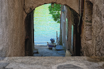 Alley to Lago di Orta on Isola San Giulio, Piedmont, Italy.