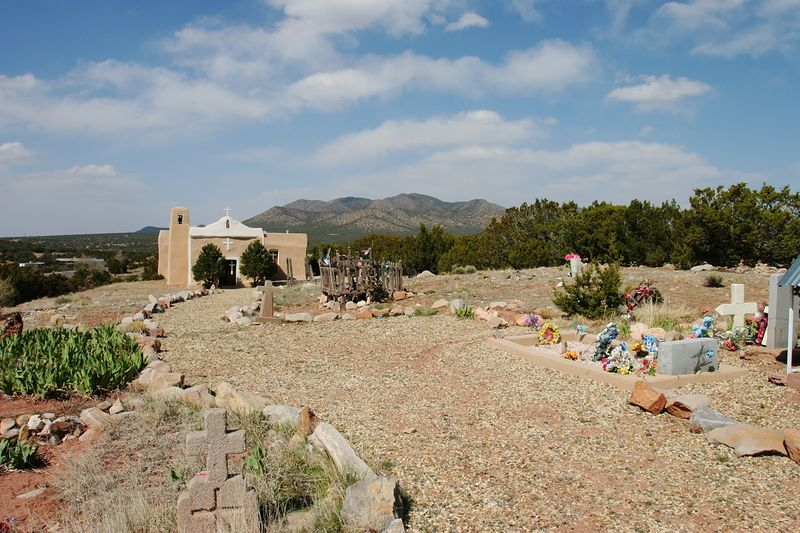 Church and cemetery on the hill in Golden, NM