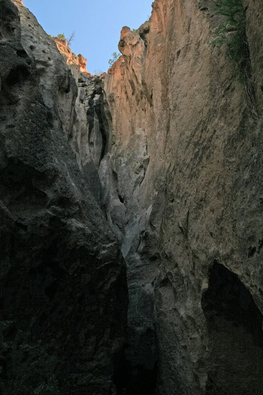 A portal on the sky from a deep crevice at the cliff base.
