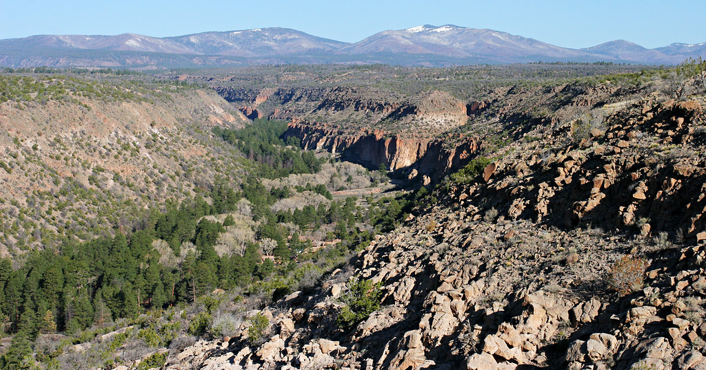 Frijoles Canyon at Bandelier National Monument. Tyuonyi pubelo ruins are barely visible in the center of the photo (visible at Original size). Arpil 9, 2005