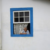 Old Women looking out her window of the historic town of<br /> Paraty, Brazil