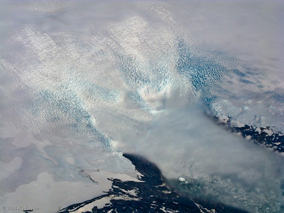 Ground fog covers the face of a glacier.