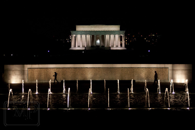 A night in DC - Standing at the World War II Memorial, looking out over the fountains, the Reflecting Pool, and the Lincoln Memorial.  There were a surprising number of people still out at that hour, but I think the two people in this photo really make it for me.