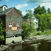 The Old Feed Store - Grain store by the river in Dover-Foxcroft Maine.  While the river is low this time of year, the flood damage that the building has sustained is evidenced in this photo.