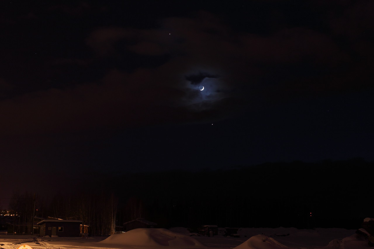Alignment of Jupiter, Venus and the Crescent Moon through Clouds III