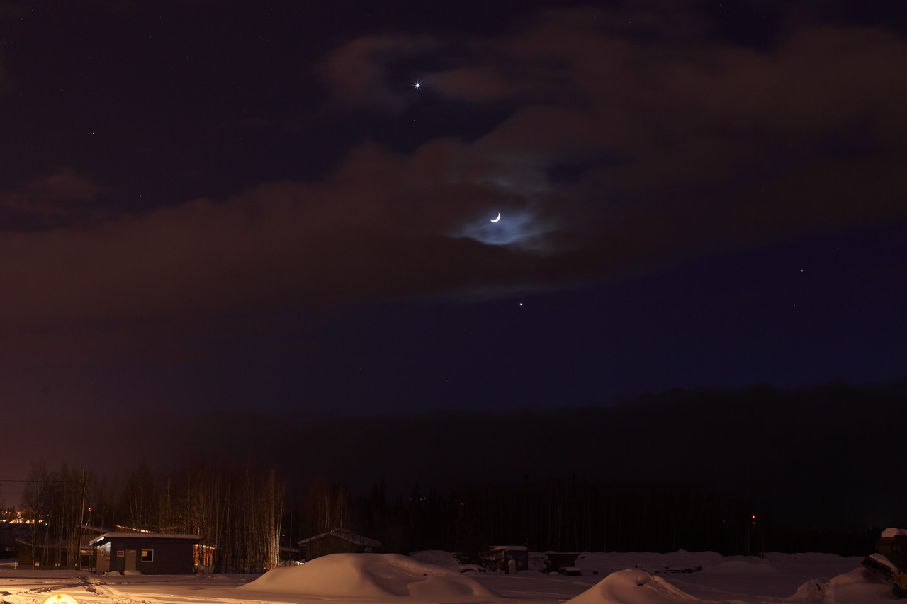 Alignment of Jupiter, Venus and the Crescent Moon through Clouds