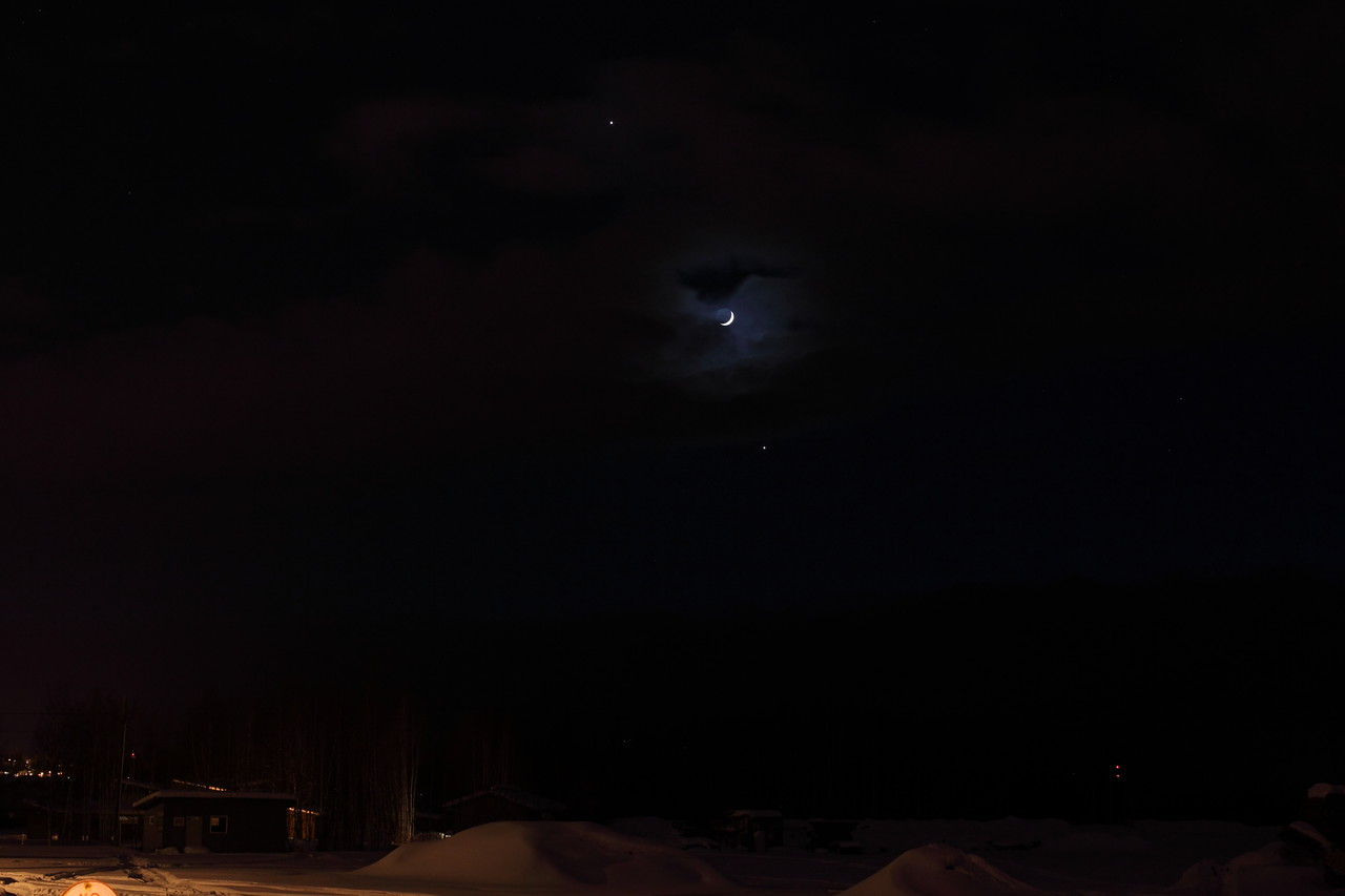 Alignment of Jupiter, Venus and the Crescent Moon through Clouds II