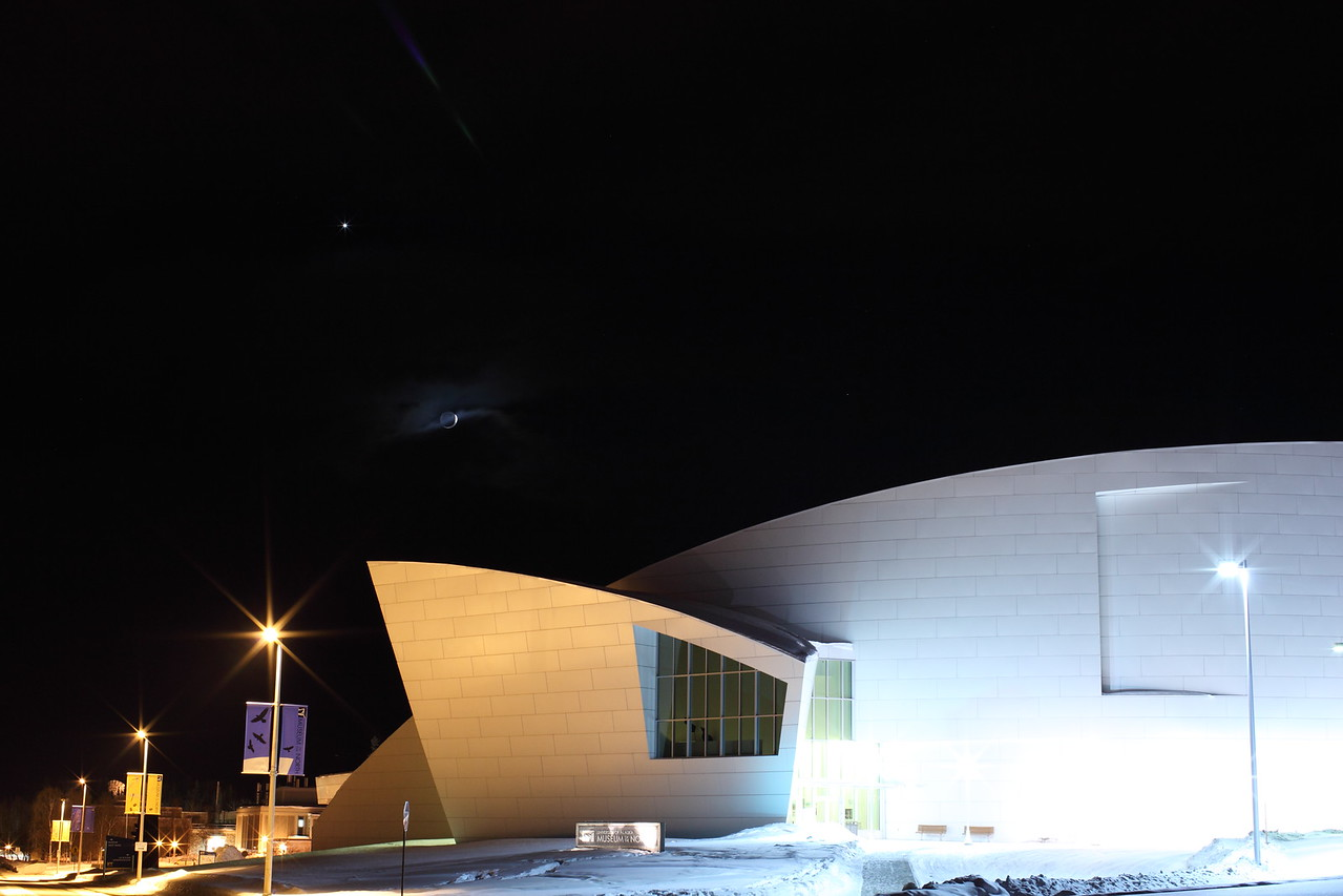 Delicate Crescent Moon over Museum of the North IV