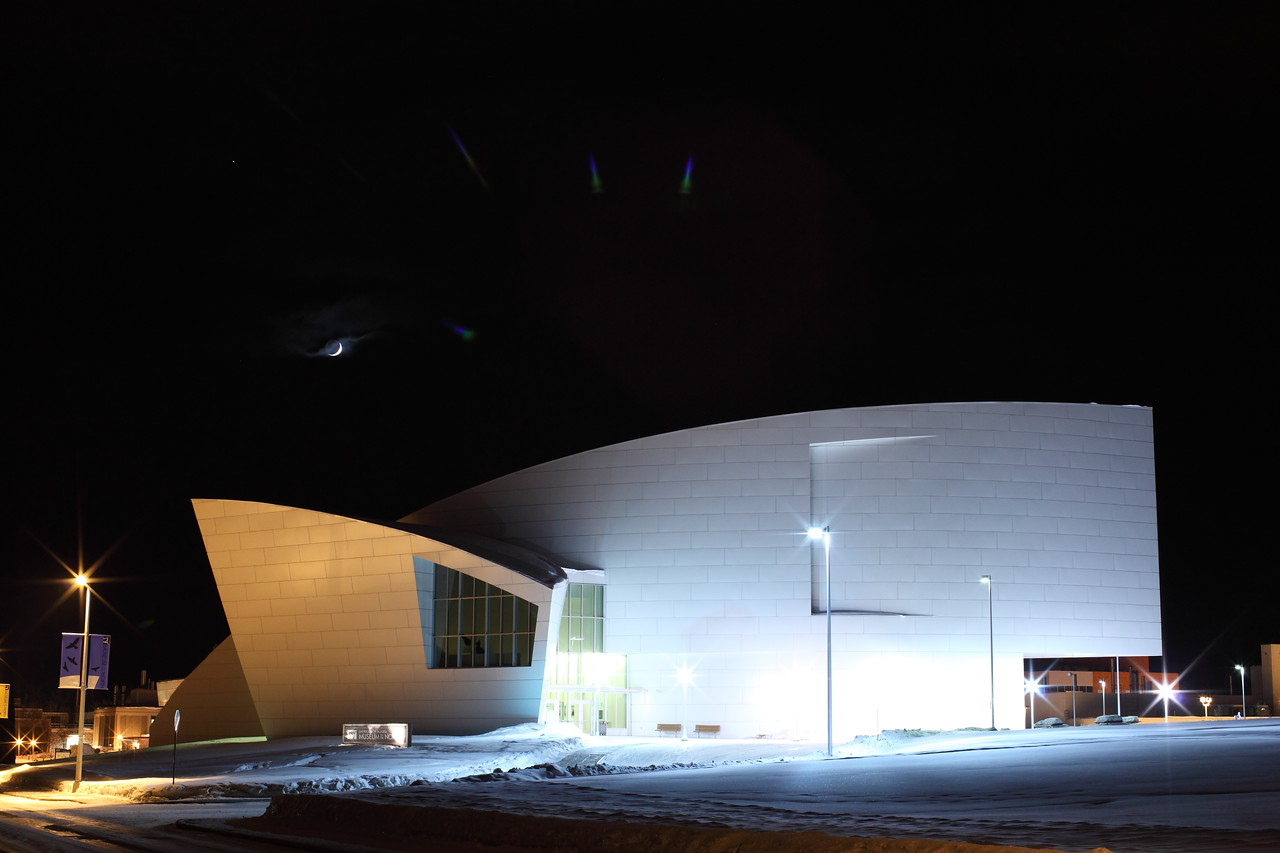 Museum of the North in Alaska with Crescent Moon