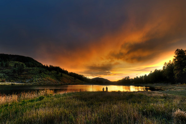 On Lake Simatico in Forest Lakes, Colorado, a Fall sunset lights the sky afire.