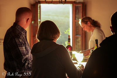 Gina preparing some appetizers and wine for our arrival - Siena, Italy ... May 26, 2013 ... Photo by Rob Page III