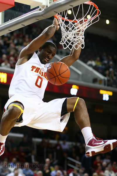 #0 Marcus Johnson dunks the ball during an NCAA mens basketball game.