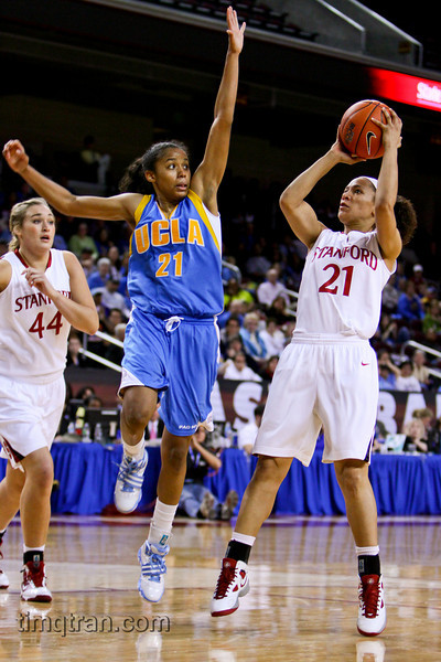 #21 Doreena Cambell of UCLA attempts to block a shot by #21 Rosalyn Gold-Onwude of Stanford during the NCAA PAC 10 Women's Basketball championship game on March 14, 2010.