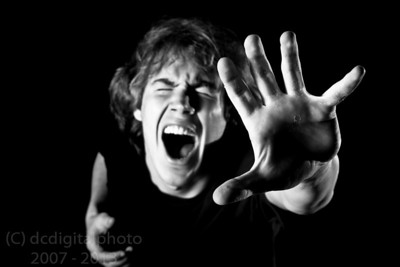 Young man screams and reaches up