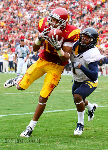 Freshman #13 Robert Woods of the USC Trojans hauls in a catch while being defended by California Golden Bears #1 Steve Williams during the NCAA football game on October 16, 2010.