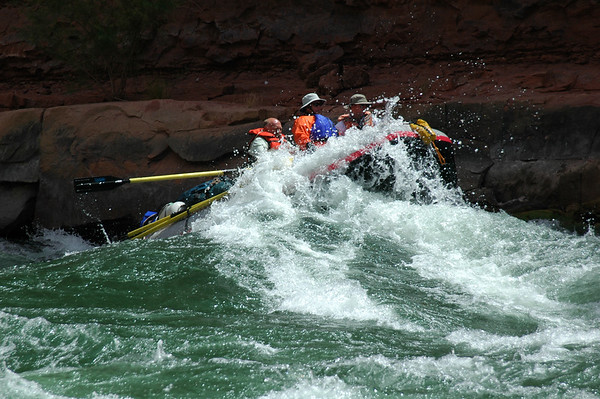 GRAND CANYON, AZ - Doug, Brian and John crash over the crest of a wave in House Rock Rapid.