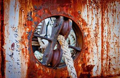 """""""RUSTED BOAT"""" (Serial No.: 20061126-1790) Cable through rusted boat in Old Port of Montreal, Canada."""