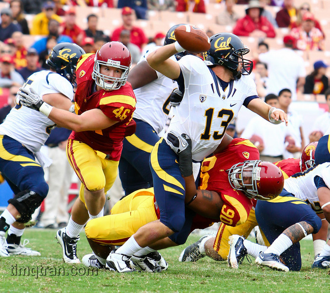 #90 Derek Simmons of the USC Trojans sacks #13 Kevin Riley of the Cal Golden Bears during their NCAA football game on October 16, 2010.