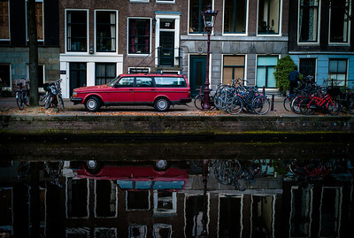 """""""RED CAR REFLECTION"""" (Serial No.: 20111001-2712) Houses, bicycles and red car reflection on a canal in Amsterdam"""