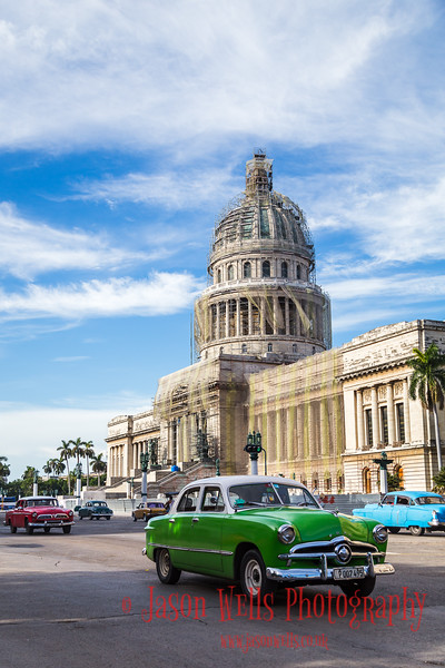 Classical cars in front of the El Capitolio.