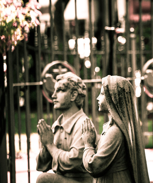 Statues praying at the St. Leaonard Church Peace Garden