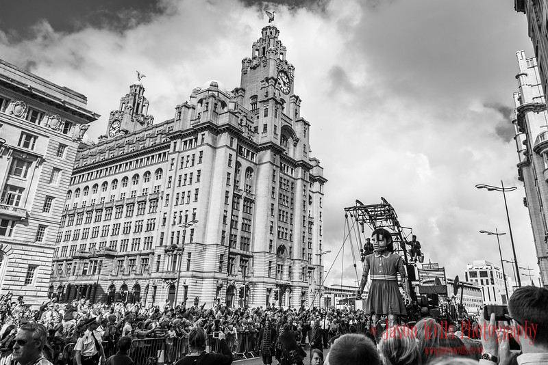 Giant little girl in front of the Three Graces.