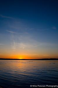 A portrait image showing the deep blue transition of the sky at sunset (East Grand Traverse Bay, Mi).