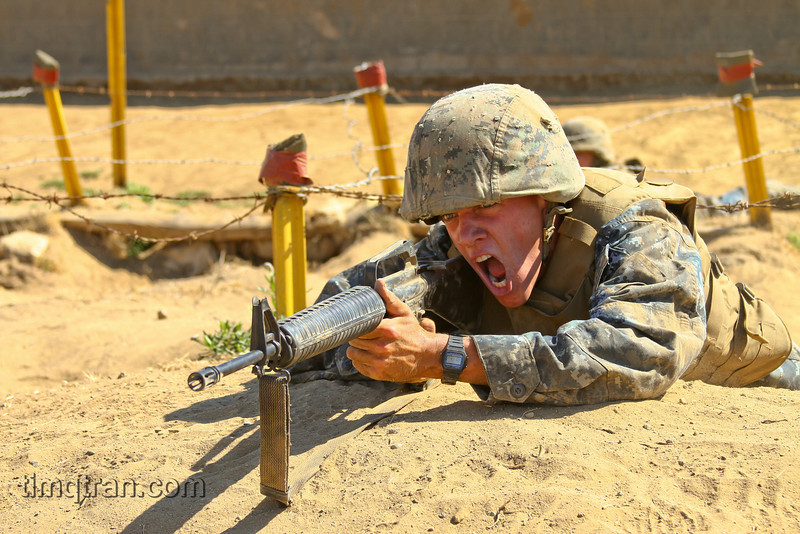 MIDN 3/C Robert Mackay yells orders to his fire team while conducting the Infiltration Course at Camp Pendleton.