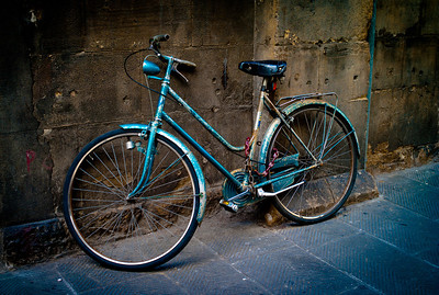 """BLUE BIKE SOLITAIRE"" (Serial No.: 20110511-2053) Old bike locked on the sideway of a cathedral in Florence, Italy."
