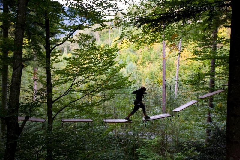 INTERLAKEN, SWITZERLAND -  Seilpark high ropes course with ziplines and balancing elements.