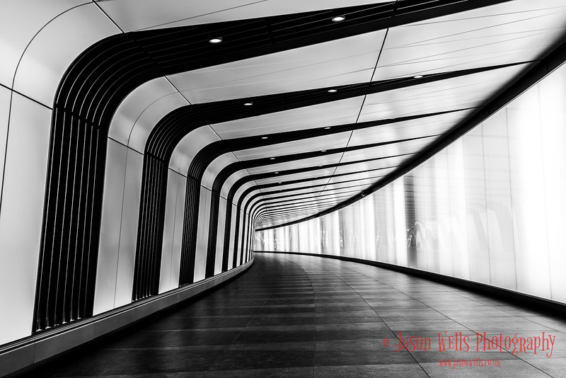 Monochrome tunnel at King's Cross.