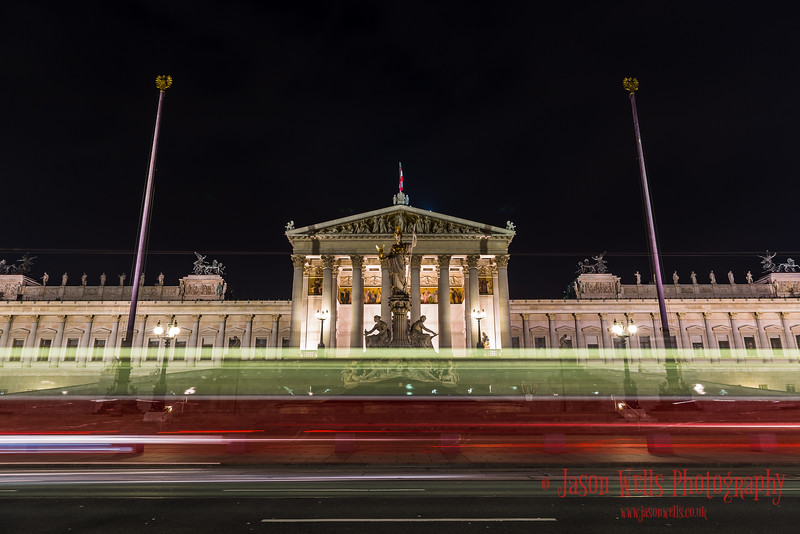 Tram trails in front of the Austrian Parliament Building.