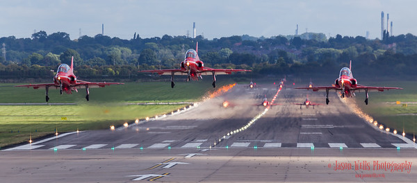 Red Arrows taking off.
