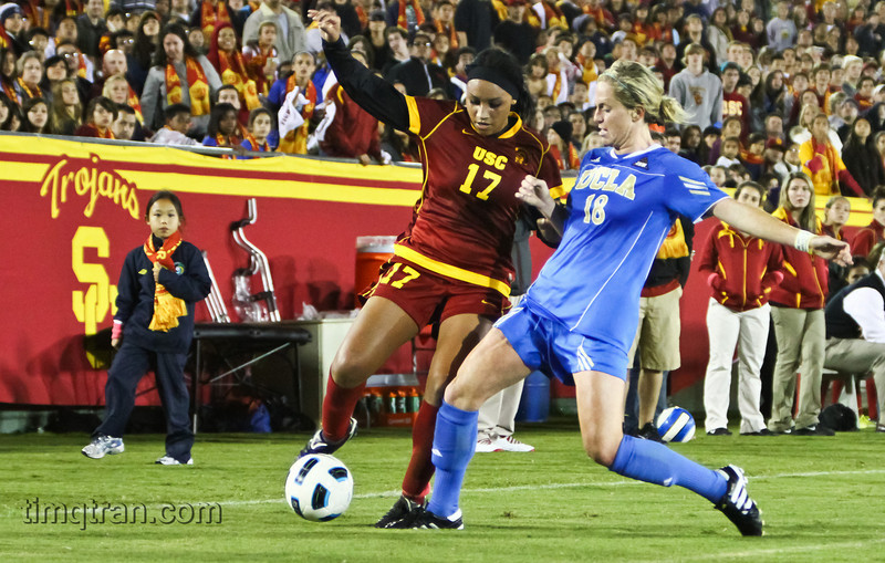 #17 Samantha Johnson of the Women of Troy and #18 Kylie Wright of the UCLA Bruins jostle for the ball during the NCAA Women's Soccer match on October 22, 2010