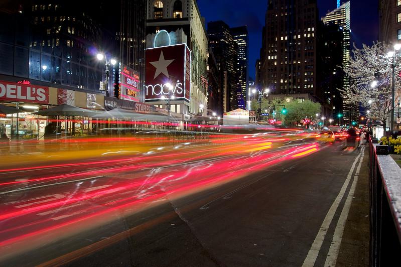 Cabs race past Macy's, NYC ref: e907e88b-2333-47e1-9d4e-a161cbb1c29f