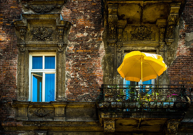 "'OLD AND NEW"" (serial No.: 20130804-5565) Colourful sun umbrella on a balcony, Krakow, Poland."