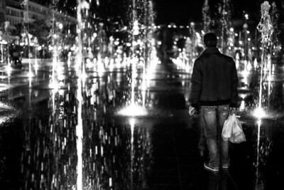"""MAN AND THE FOUNTAINS"" (serial No.: 20131111-6236) Observing man on La Coulée Verte, Nice, Côte d'Azur, France"