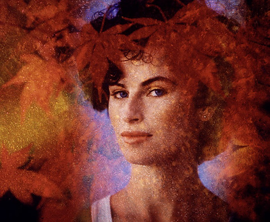 An image of a woman and an image of autumn leaves merged in analogue fashion - no computers.