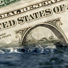 """Another 'Sinking Dollar' 'Sinking Economy, inflation, recession image.  This image is placed with Corbis. To License it, copy  this image number:  42-20668931   and go to <a href=""""http://pro.corbis.com/Search/SearchResults.aspx?pg=Bryan%20Allen&ri=CRB003616&options=true&lic=1&mt=2&cf=1&p=1"""">my pages at Corbis.</a>"""