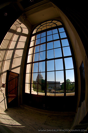 The United States Capitol Dome through the window of the Rotunda at the Russell Senate Office building on Captiol Hill.