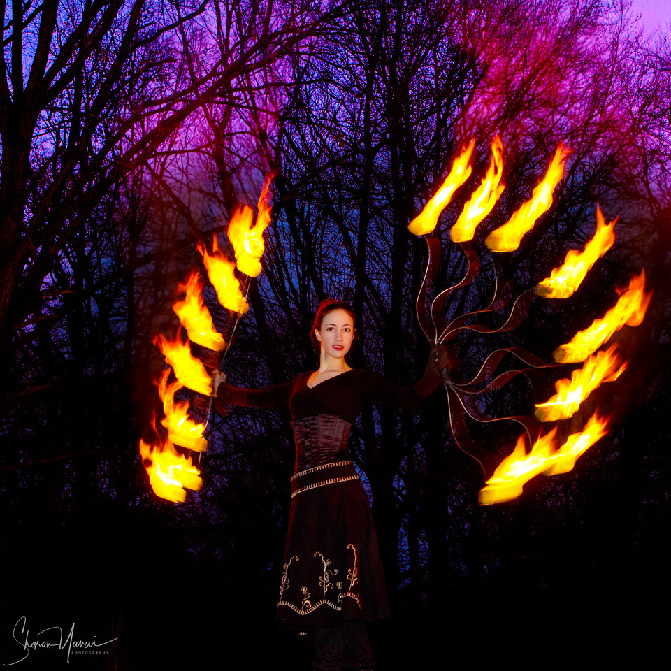 Fire games - woman artist presents a fire art show