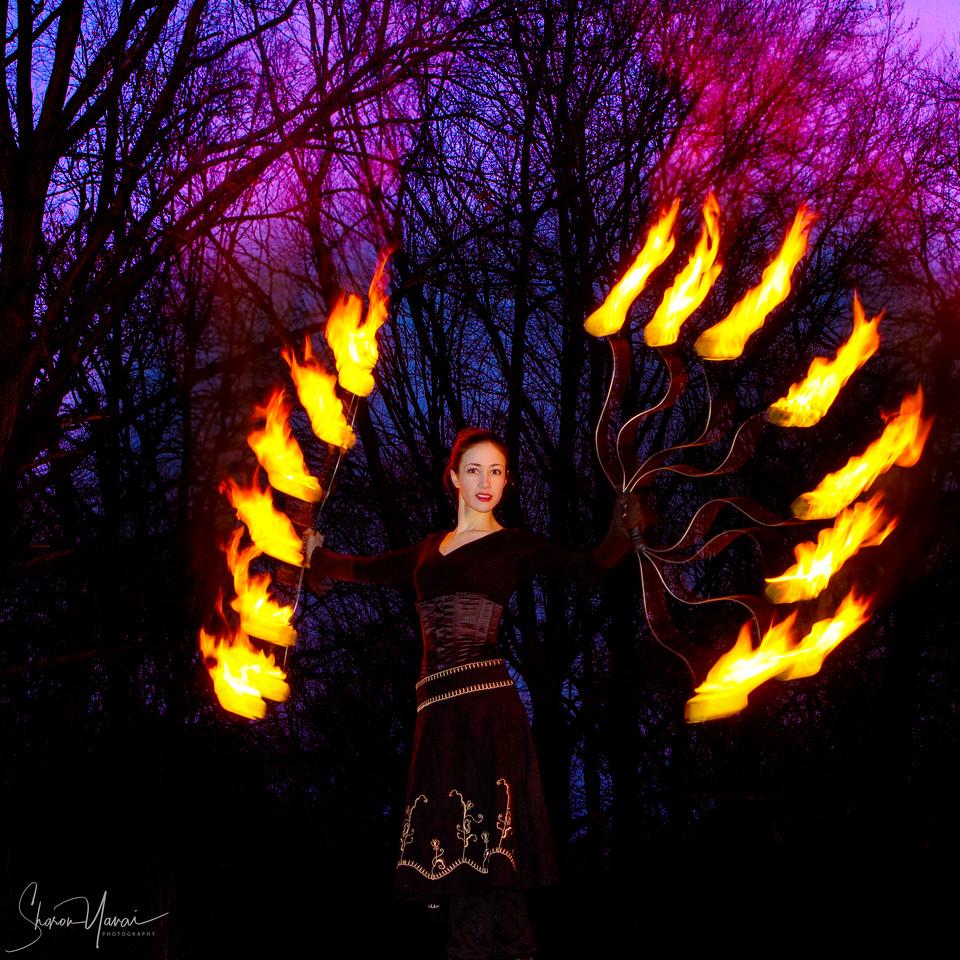 Woman artist presents a fire art show