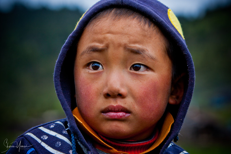 Chinese Boy with a sad look, Shangri La, China