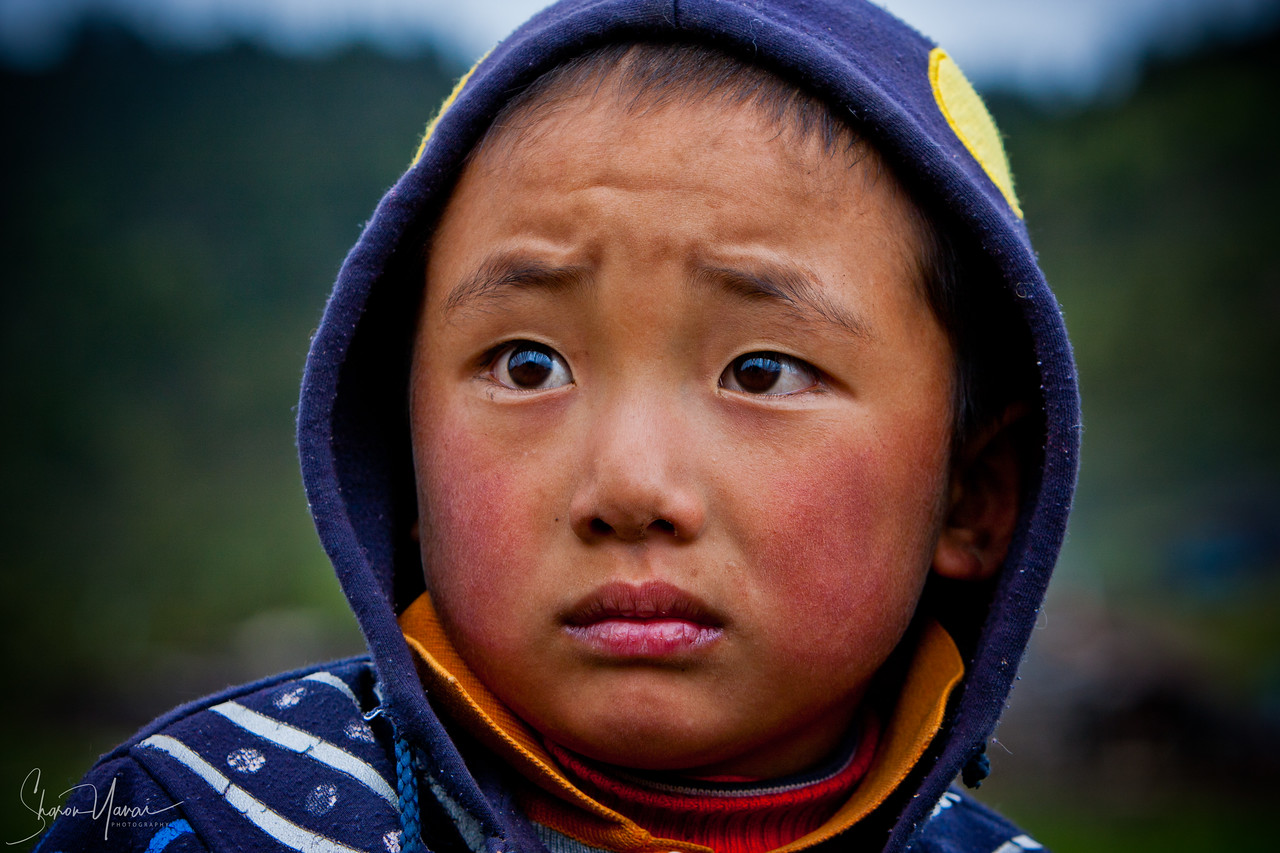 Chinese Boy with a sad look, Shangri La, China