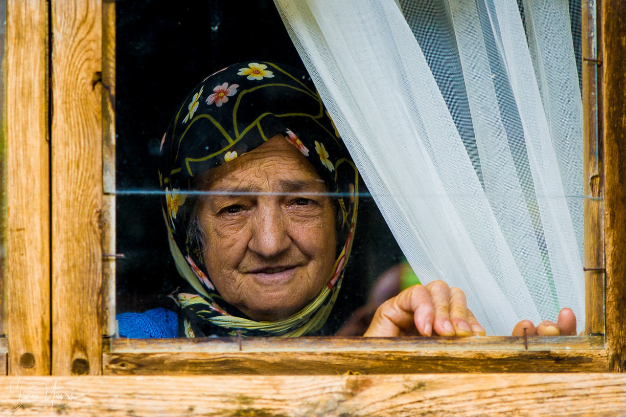 Old Turkish woman at the window